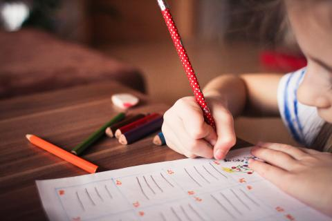 Image of young girl writing